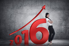 Asian business person lean next to 2016 number Royalty Free Stock Photo