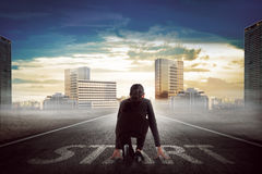 Asian business person ready to run toward the city Royalty Free Stock Photo