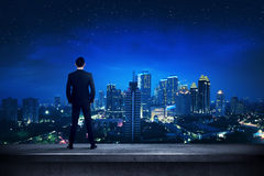 Asian business person standing on the rooftop Stock Photography
