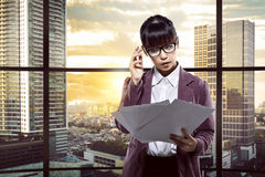 Asian business person thinking hard Stock Photography