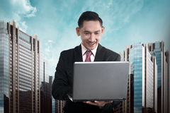 Asian business person typing on laptop Stock Photography