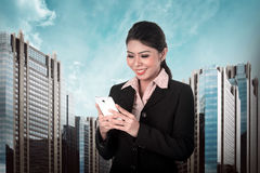 Asian business person typing on laptop Royalty Free Stock Photos