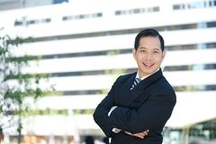 Asian business smiling with arms crossed Royalty Free Stock Photo