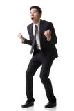 Asian business surprised. With outrageously and funny pose, full length portrait isolated on white background Royalty Free Stock Photo