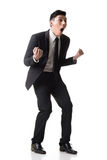 Asian business surprised. With outrageously and funny pose, full length portrait isolated on white background Stock Photos