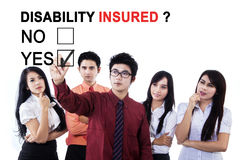 Asian business team approving disability insured Stock Image