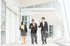 Asian business team discussing Stock Image