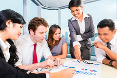 Asian business team discussing report Stock Photo