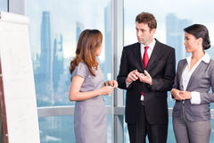 Asian business team in front of urban skyline Stock Photography