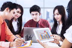 Asian business discussion at office. Asian business team is having a discussion in the office Royalty Free Stock Photos