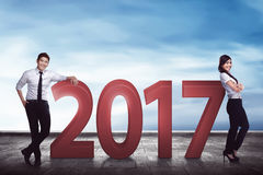 Asian business team lean on 2017 number. Business target concept Stock Photos