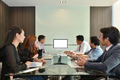 Asian Business team meeting in front of a computer with blank sc royalty free stock images