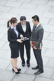 Asian Business team meeting with tablet. Stock Images