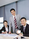 Asian business team. A team of asian business people working together in office Royalty Free Stock Photography