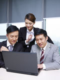 Asian business team. A team of asian business people working together in office Stock Photo