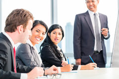 Asian business team in presentation Royalty Free Stock Images