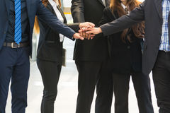 Asian Business Team showing Unity with their hands together Royalty Free Stock Photo