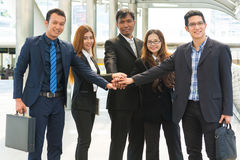 Asian Business Team showing Unity with their hands together. As Business Teamwork Concept Stock Image