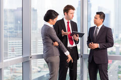 Asian business team - urban skyline Stock Photography
