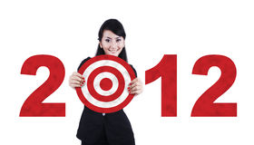 Asian business woman with 2012 business target. Beautiful Asian Woman with a New business year target Stock Photos
