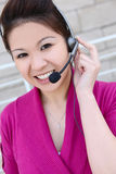 Asian Business Woman. An asian customer service employee thinking and listening to the client Royalty Free Stock Photo