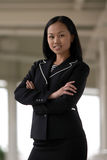 Asian Business Woman with Arms Folded Smiling. Asian Business Woman with Arms Folded Royalty Free Stock Image