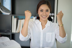 Asian business woman arms up for Celebration Success Working ,Su Royalty Free Stock Image