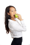 Asian Business Woman bite apple Stock Image