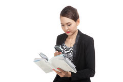 Asian business woman with a book and magnifying glass Stock Photo