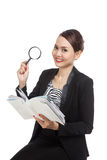 Asian business woman with a book and magnifying glass Stock Photos