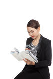 Asian business woman with a book and magnifying glass Royalty Free Stock Image