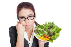 Asian business woman bored with salad bowl royalty free stock photo