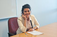Business woman call to inquire more details about document. Asian business woman call to inquire more details about the document Royalty Free Stock Photo