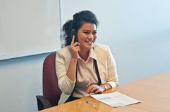 Business woman call to inquire more details and talk. Asian business woman call to inquire more details and talk over phone Royalty Free Stock Photography