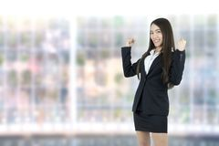Asian business woman celebrating cheerful for her success on office background. stock photography