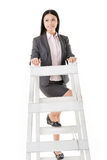 Asian business woman climb a ladder Royalty Free Stock Photo