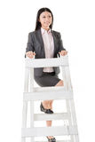 Asian business woman climb a ladder Stock Image