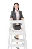 Asian business woman climb a ladder Stock Photography