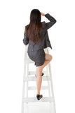 Asian business woman climb a ladder Stock Photos