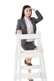 Asian business woman climb a ladder Royalty Free Stock Photography