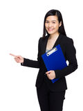 Asian business woman with clipboard and finger point out Stock Photo