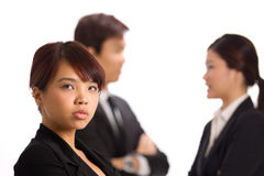 Asian Business woman with colleague in background Stock Images
