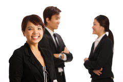 Asian Business woman with colleague in background Royalty Free Stock Image