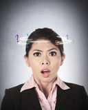 Asian Business Woman Confused. With question mark around her head Stock Photography