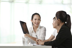 Asian Business woman with a Digital Tablet Royalty Free Stock Photography