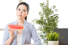 Asian business woman drinking summer sweet fruit watermelon Stock Photo