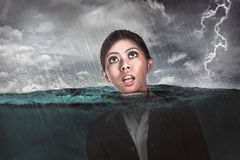 Asian business woman drown in the middle of the sea Royalty Free Stock Photography