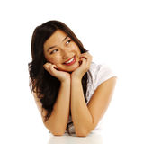 Asian business woman with elbows on white block Royalty Free Stock Photos