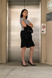 Asian Business Woman at Elevator. Asian Business Woman Waiting for Elevator Stock Images