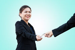 Asian business woman is exchanging credit card. Take photo with DSLR camera in studio Royalty Free Stock Photography